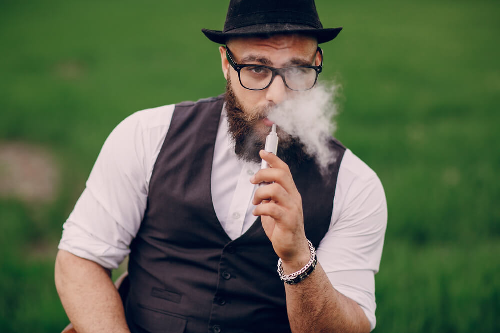 Man vaping his favourite tasting distillate